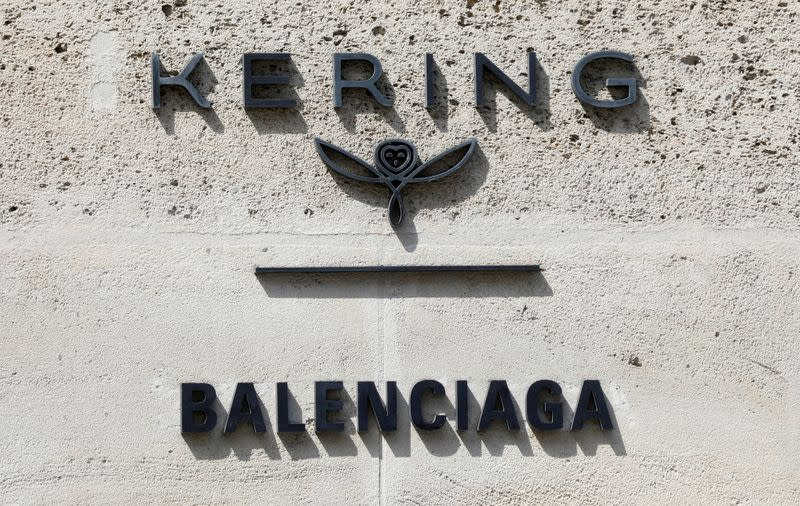 FILE PHOTO: The logos of French luxury group Kering and fashion house Balenciaga