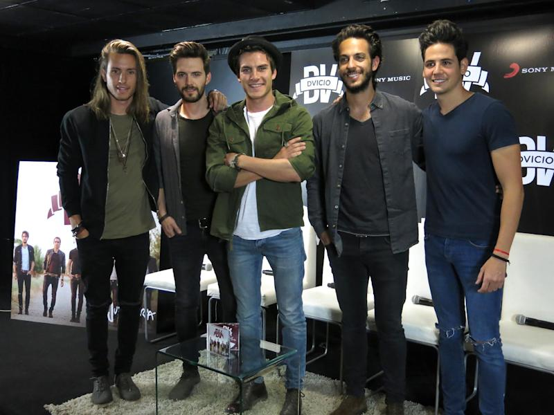 """FILE - In this April 20, 2016 photo, the members of the Spanish band Dvicio, from left, Martin Ceballos, Luis Gonzalvo, Andres Ceballos, Nacho Gotor and Alberto Missis pose for a portrait during a press conference promoting the launch of their album """"Justo ahora"""" in Mexico City. Dvicio announced the Latin Grammy for the late Mexican musical star Juan Gabriel, for the best traditional vocal pop album category for """"Los duo 2."""" (AP Photo/Berenice Bautista, File)"""