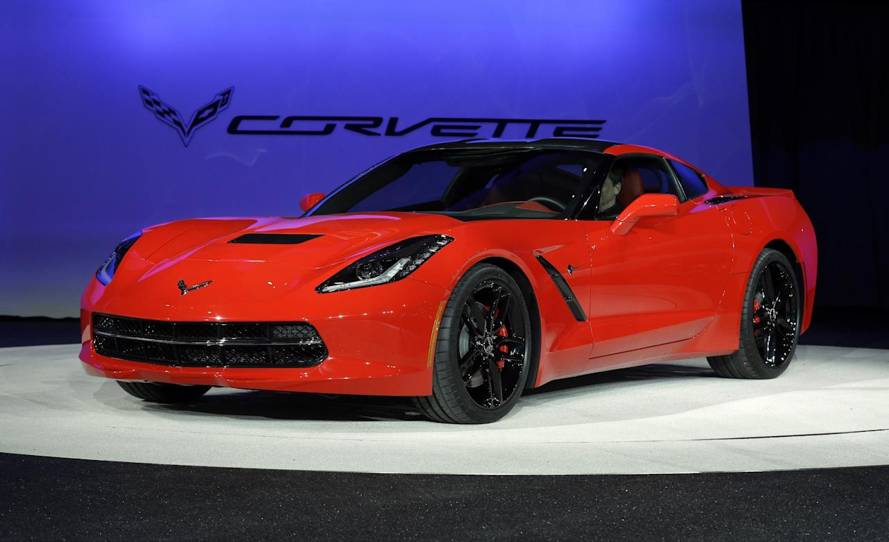 The 2014 Chevrolet Corvette Stingray is revealed at media previews for the North American International Auto Show in Detroit, Monday, Jan. 14, 2013. (AP Photo/Paul Sancya)