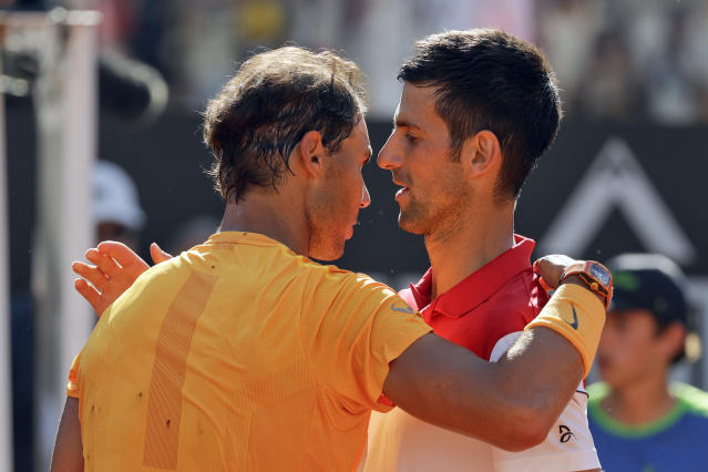 Spain's Rafael Nadal, left, hugs Serbia's Novak Djokovic at the end of their semifinal match, at the Italian Open tennis tournament, in Rome, Saturday, May 19, 2018. Rafael Nadal was challenged in the first set by Novak Djokovic before pulling away for a 7-6 (4), 6-3 win to reach the Italian Open final on Saturday. (AP Photo/Gregorio Borgia)