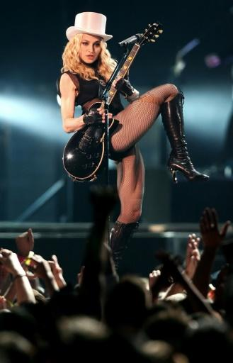 American singer Madonna performs at the Cardiff Millennium Stadium in August 2008