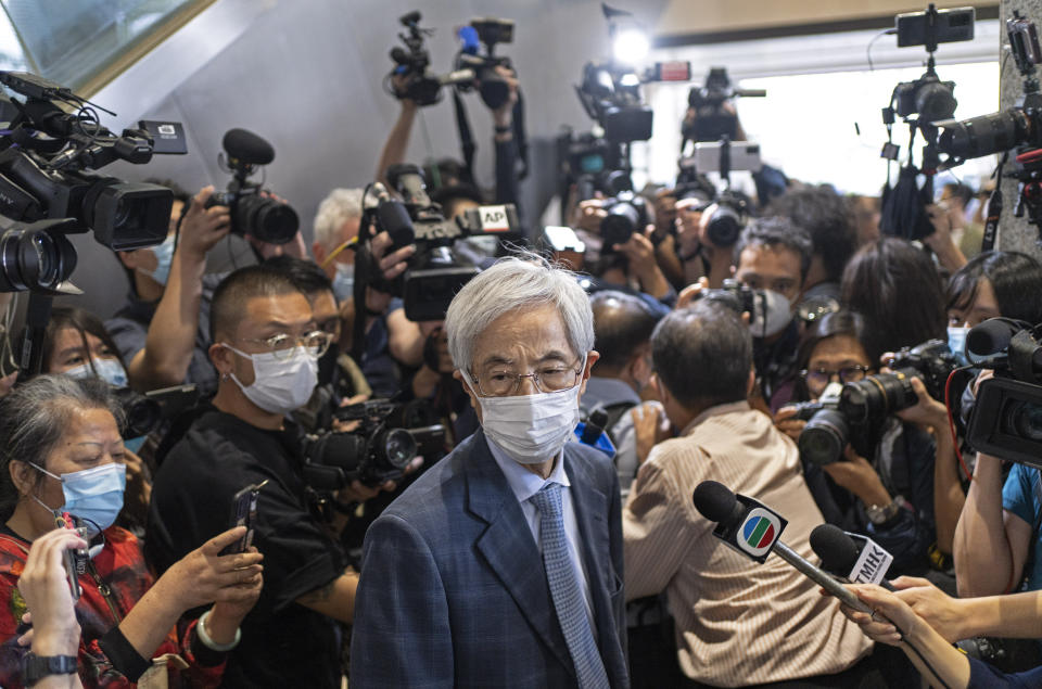 Pro-democracy activist Martin Lee, center, walks out from a court after receiving a suspended sentence in Hong Kong, Friday, April 16, 2021. A Hong Kong court on Friday sentenced five leading pro-democracy advocates, including media tycoon Jimmy Lai, to up to 18 months in prison for organizing a march during the 2019 anti-government protests that triggered an overwhelming crackdown from Beijing. A total of nine advocates were given jail terms, but four of them, including 82-year-old Lee, had their sentences suspended after their age and accomplishments were taken into consideration. (AP Photo/Vincent Yu)