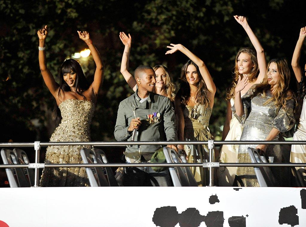 "Pharrell Williams and a bevy of model beauties, including Naomi Campbell, partied on a bus outside the glamorous event. Kevin Mazur/<a href=""http://www.gettyimages.com/"" target=""new"">GettyImages.com</a> - September 7, 2010"