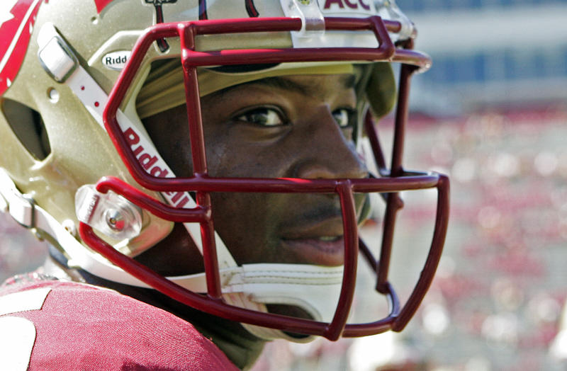 FILE - In this Oct. 5, 2013, file photo, Florida State's Jameis Winston looks around during warms ups prior to an NCAA college football game against Maryland in Tallahassee, Fla. Winston envisioned winning the Heisman Trophy before signing with the top-ranked Seminoles. He is one of six finalists for the award and will find out Saturday if his dream comes true. (AP Photo/Steve Cannon, File)