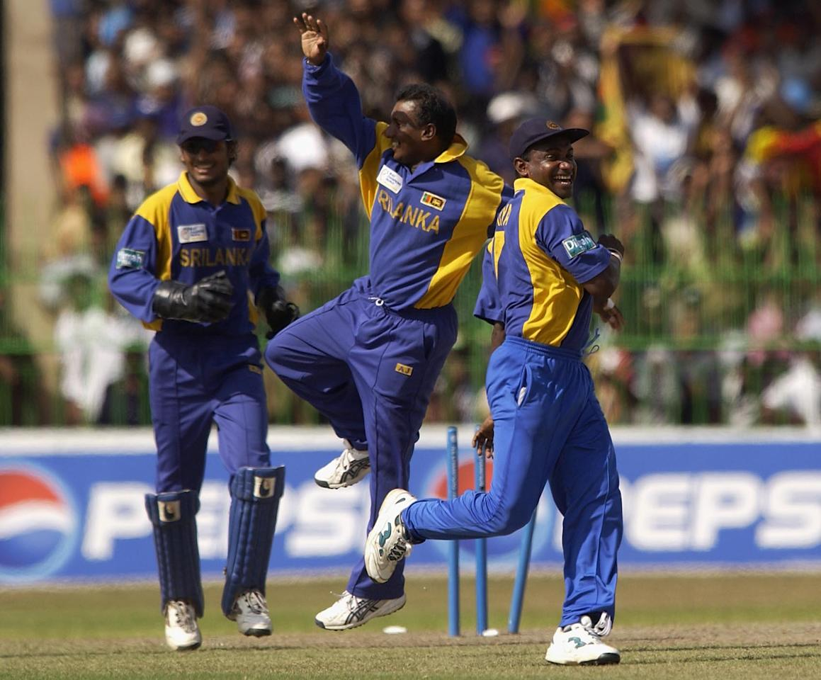 COLOMBO - SEPTEMBER 27:  Sanath Jayasuriya and Aravinda de Silva celebrate the run out of Darren Lehmann of Australia during the Australia v Sri Lanka Semi Final match of the ICC Champions Trophy at the R. Premadasa Stadium, Colombo, Sri Lanka on September 27, 2002. (Photo by Tom Shaw/Getty Images)