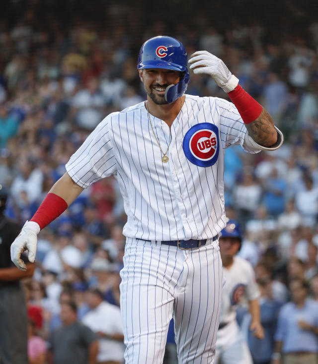 Chicago Cubs' Nicholas Castellanos smiles after hitting a solo home run against the Oakland Athletics during the first inning of a baseball game, Monday, Aug. 5, 2019, in Chicago. (AP Photo/Kamil Krzaczynski)