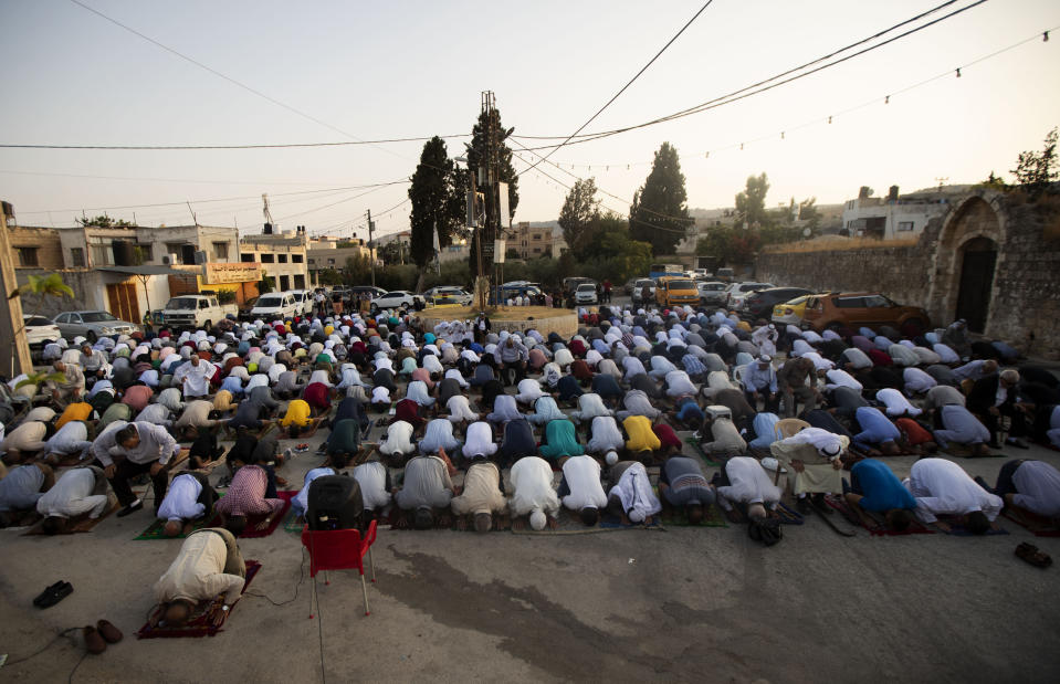 Muslims offer Eid al-Adha prayers in the village of Salem, near of the West Bank city of Nablus, Tuesday, July 20, 2021. (AP Photo/Majdi Mohammed)