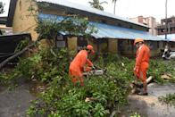 ALIBAUG, INDIA - JUNE 3: NDRF team cutting trees fallen on house at Alibag beach due Nisarga Cyclone landfall on June 3, 2020 in Alibaug, India. Alibaug witnessed wind speeds of up to 120 kilometres per hour. Although the cyclone made the landfall just 95 kilometres from Mumbai, the Maharashtra capital largely escaped its wrath. (Photo by Satish Bate/Hindustan Times via Getty Images)