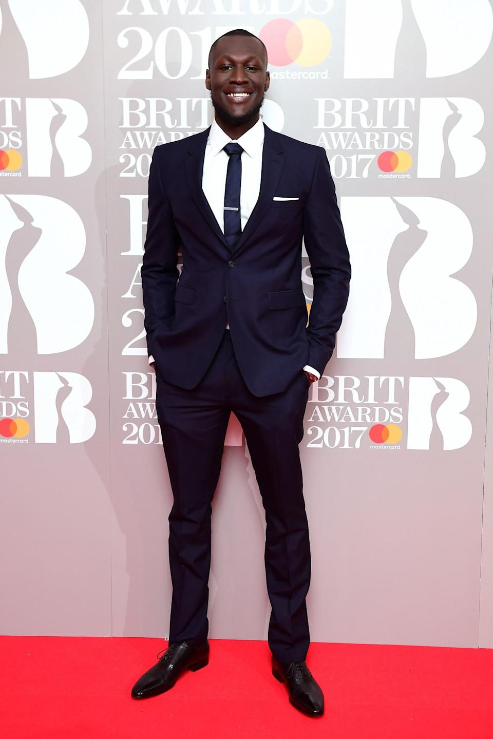 <p>Stormzy was extremely dapper in a navy suit. <i>[Photo: PA]</i> </p>