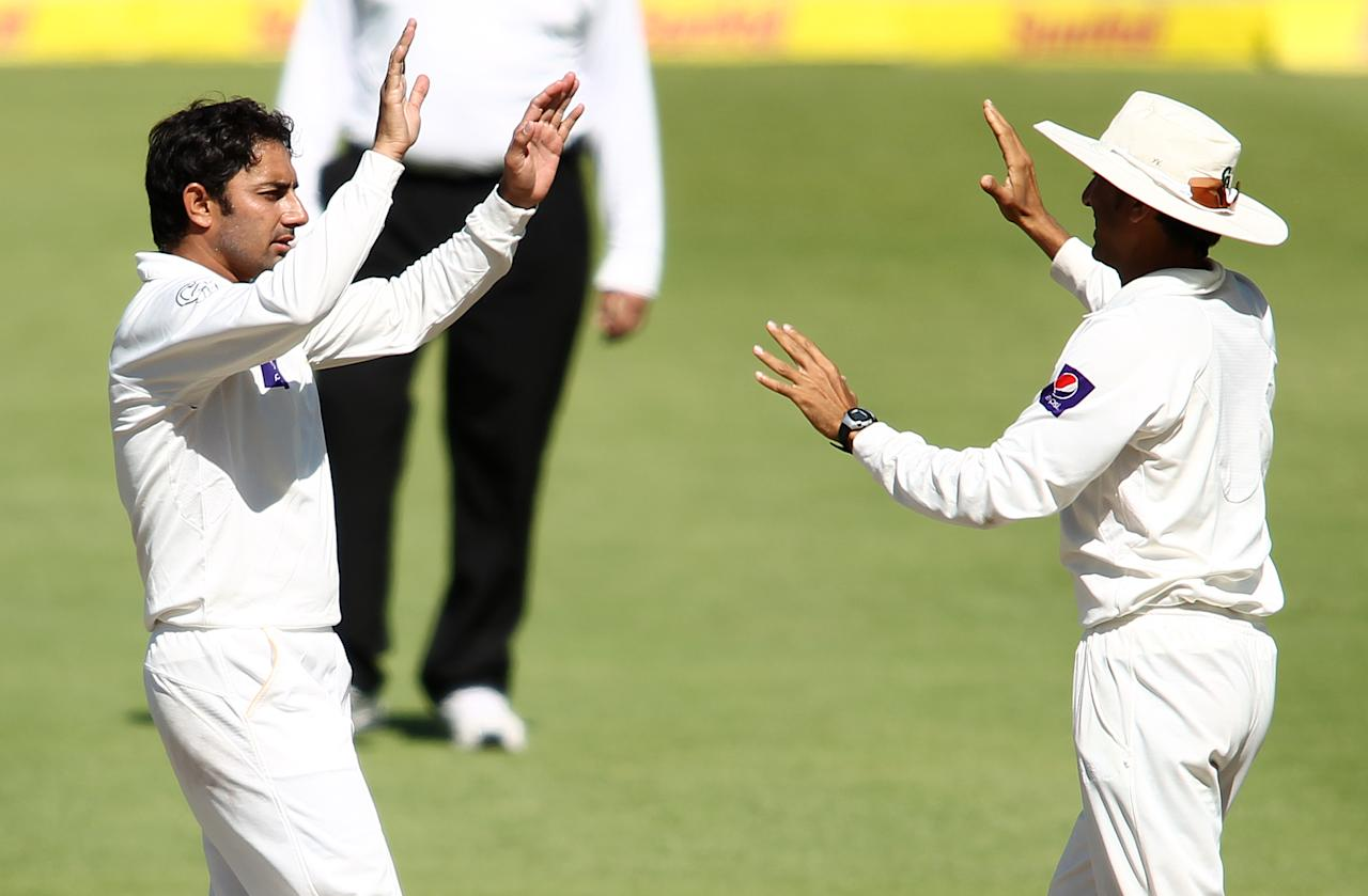 CAPE TOWN, SOUTH AFRICA - FEBRUARY 17:  Saeed Ajmal of Pakistan is congratulated by Younis Khan of Pakistan after getting thw wicket of Jacques Kallis of South Africa during day 4 of the 2nd Sunfoil Test match between South Africa and Pakistan at Sahara Park Newlands on February 17, 2013 in Cape Town, South Africa. (Photo by Shaun Roy/Gallo Images/Getty Images)