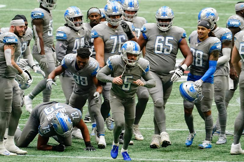 Lions kicker Matt Prater celebrates a game-winning extra point against the Falcons during the second half of the Lions' 23-22 win on Sunday, Oct. 25, 2020, in Atlanta.