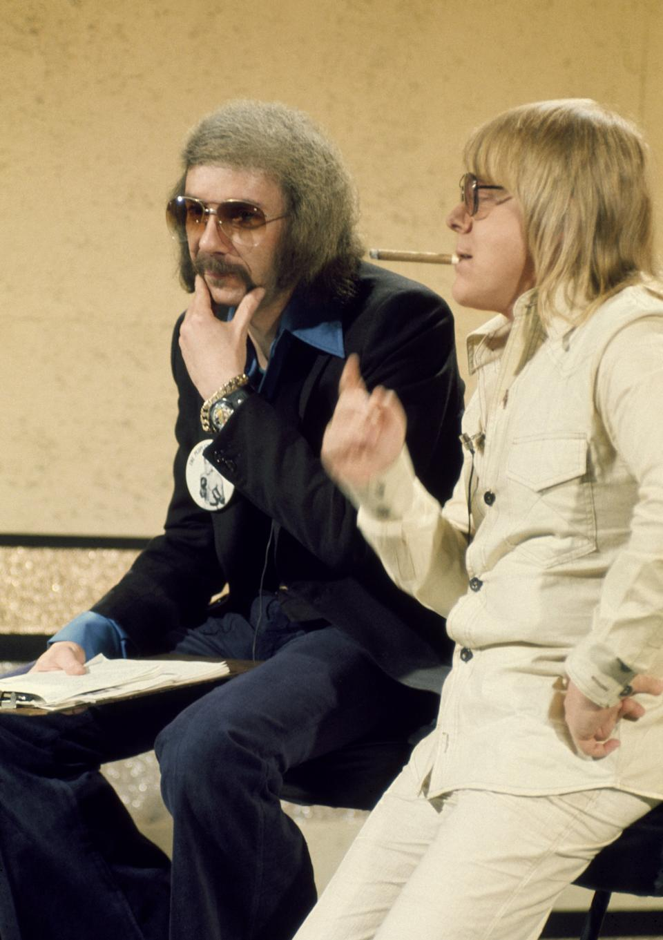 SATURDAY EVENING POST -- Aired 12/14/74 -- Pictured: (l-r) Record producer Phil Spector and singer/actor Paul Williams -- Photo by: NBCU Photo Bank