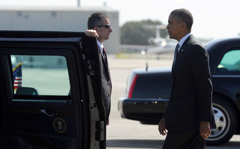 """President Barack Obama arrives at Southwest Florida International Airport in Ft. Myers, Fla., Friday, July 20, 2012. Obama is cutting short a Florida campaign swing following the deadly Colorado movie theater shooting. He called the shooting """"horrific"""". (AP Photo/Susan Walsh)"""