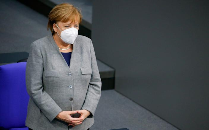 FILE PHOTO: German Chancellor Angela Merkel attends a session at the lower house of parliament Bundestag on the start of the coronavirus disease (COVID-19) vaccinations, in Berlin, Germany, January 13, 2021. REUTERS/Michele Tantussi/File Photo - MICHELE TANTUSSI/REUTERS