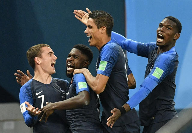 <p>France's Samuel Umtiti, second from left, is congratulated by his teammates France's Antoine Griezmann, Raphael Varane and Paul Pogba, from left, after scoring the opening goal during the semifinal match between France and Belgium at the 2018 soccer World Cup in the St. Petersburg Stadium in St. Petersburg, Russia, Tuesday, July 10, 2018. (AP Photo/Martin Meissner) </p>