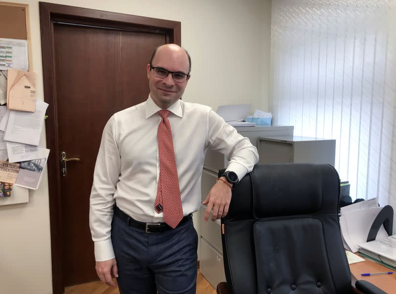 Director of the Russian Central Bank's Monetary Policy Department Zabotkin poses for a picture during an interview in Moscow