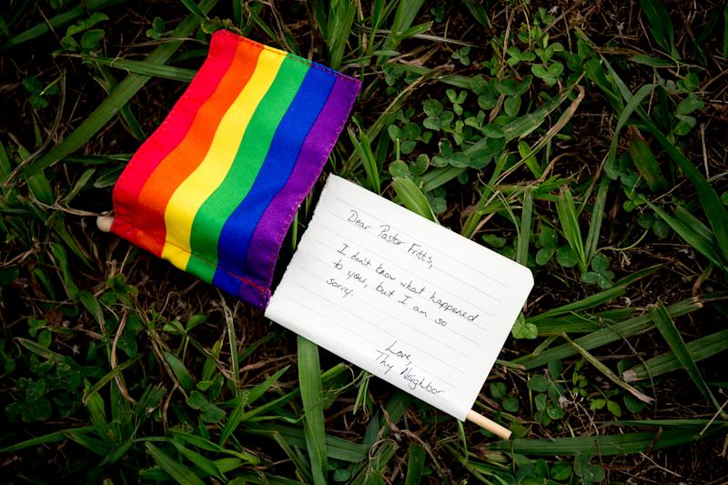 "A person who wished to remain unidentified dropped off a Pride flag with an attached note reading ""Dear Pastor Fritts, I don't know what happened to you, but I am so sorry. Love, Thy Neighbor"" at All Scripture Baptist Church on Cherry Street in Knoxville, Tennessee on Wednesday, June 12, 2019. Fritts has come under fire for preaching in a recent sermon that the government should arrest and execute LGBTQ community members."