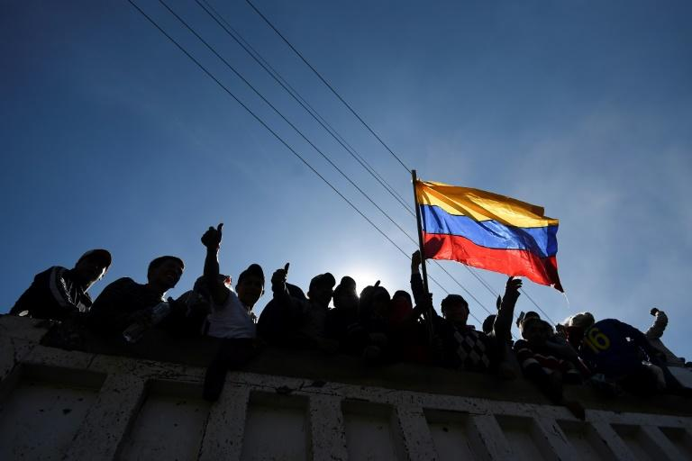 Indigenous protesters wave the Ecuador flag in celebration after the president and protest leaders reached an agreement