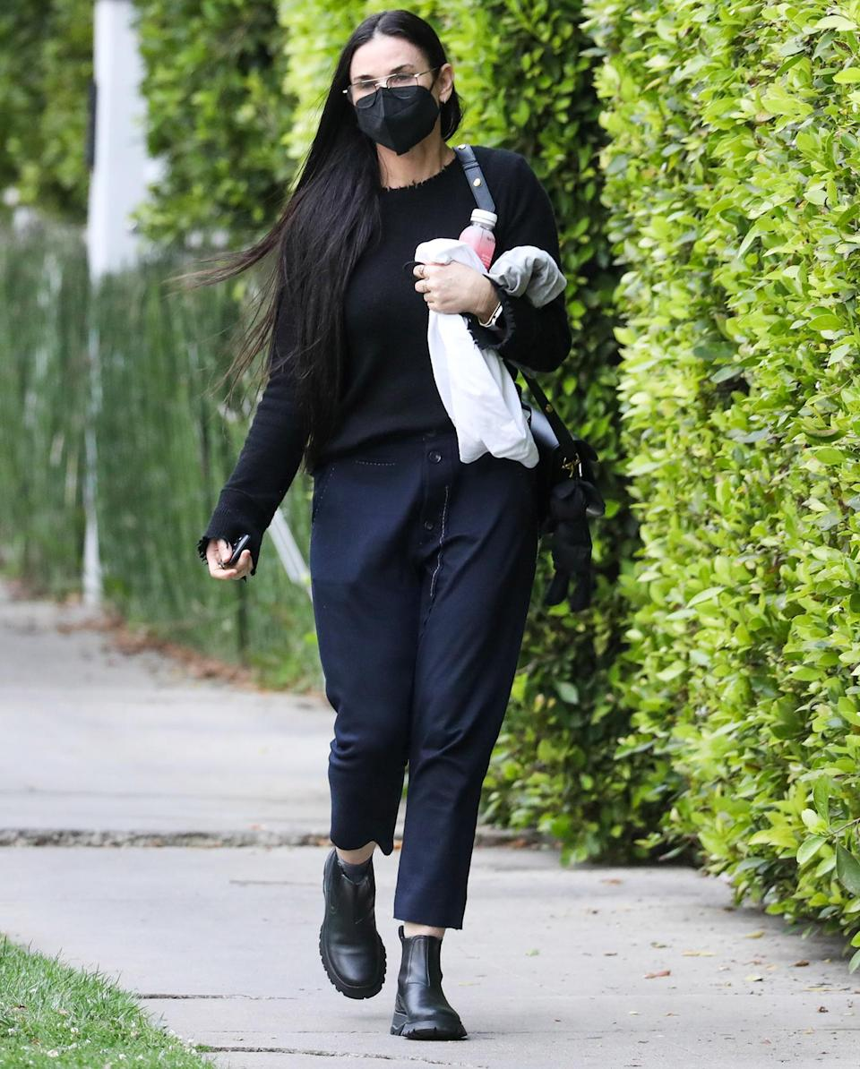 <p>Demi Moore leaves her pilates class in a black mask and matching sweater on Wednesday in L.A.</p>