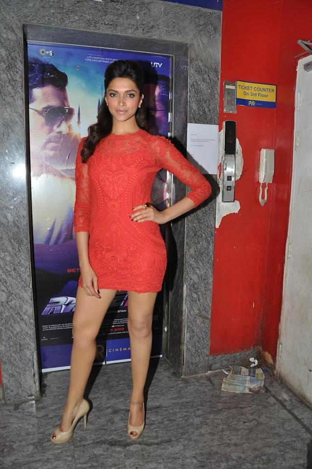 The girl with probably the sexiest legs in the industry, Deepika stands tall and looks upber hot in her red lace dress and nude peep toes.
