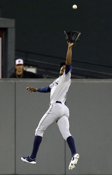 Tampa Bay Rays center fielder B.J. Upton leaps to catch a fly ball by Baltimore Orioles' Adam Jones in the first inning of a baseball game in Baltimore, Wednesday, Sept. 12, 2012. (AP Photo/Patrick Semansky)