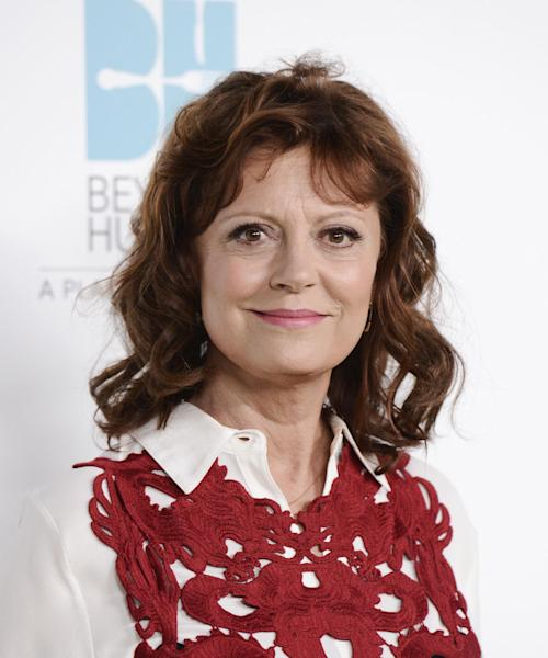 "FILE - In this Sept. 19, 2013 file photo, actress and honoree Susan Sarandon arrives at the 2nd Annual ""Beyond Hunger: A Place at the Table"" at the Montage Beverly Hills Hotel, in Beverly Hills, Calif. Architectural Digest says Sarandon will collaborate with designer David Rockwell on a photo installation inside the Oscars' green room on March 2, 2014. The 67-year-old actress is working with the veteran architect and designer to curate a digital display of images honoring movie heroes and Oscar history. (Photo by Dan Steinberg/Invision/AP, file)"