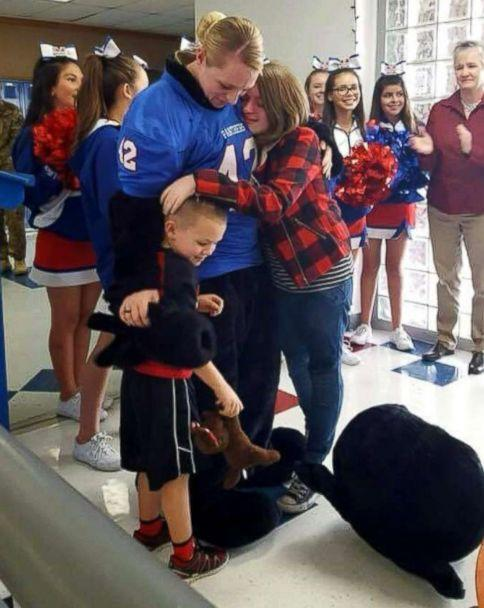 PHOTO: Sgt. Lacey Poltoratskiy surprised her 7th grade daughter, JaiceyBelle Hunter, and kindergartner son, Daxton Hunter at their schools on Monday. (Midway ISD)