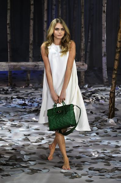 Cara Delevingne models The Cara Delevingne Collection created by Mulberry at London Fashion Week Autumn/ Winter 2014 on Sunday, Feb. 16, 2014 at Claridges in London. (Photo by Richard Chambury/Invision/AP Images)