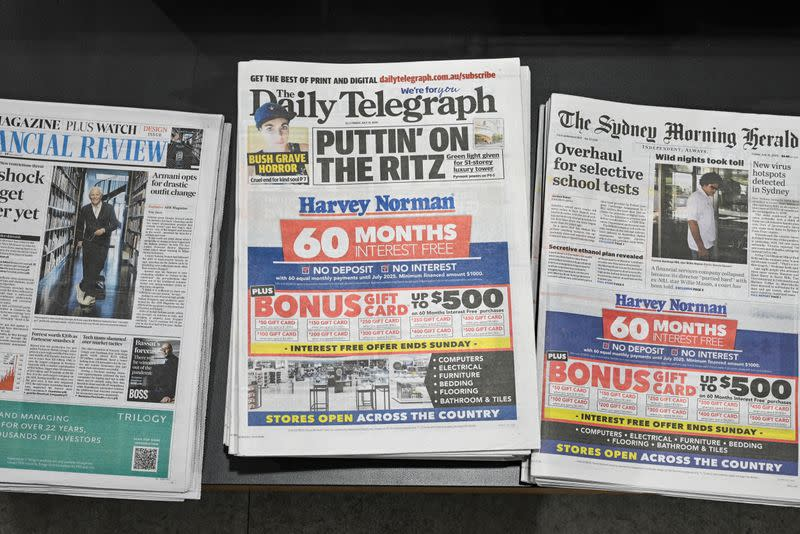 Newspapers are seen for sale at a shop in Sydney