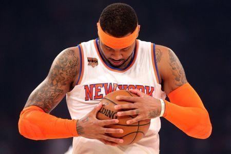 Apr 6, 2017; New York, NY, USA; New York Knicks small forward Carmelo Anthony (7) inspects the ball before a game against the Washington Wizards at Madison Square Garden. Mandatory Credit: Brad Penner-USA TODAY Sports