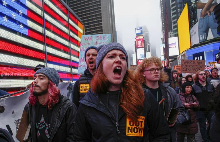 Demonstrators opposed to the US military presence in Iraq march in New York (AFP Photo/Kena Betancur)