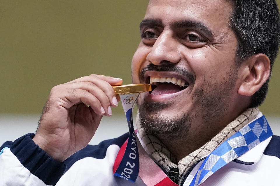 Javad Foroughi, of Iran, celebrates after winning the gold medal in the men's 10-meter air pistol at the Asaka Shooting Range in the 2020 Summer Olympics, Saturday, July 24, 2021, in Tokyo, Japan. (AP Photo/Alex Brandon)