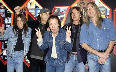Malcolm Young, far left, with Brian Johnson, Angus Young, Phil Rudd and Cliff Williams from AC/DC - Credit: Yui Mok