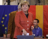 FILE - In This Sunday, Sept. 24, 2017 file photo, German Chancellor Angela Merkel casts her vote for the federal parliament election in Berlin, Germany. German voters elect a new parliament on Sunday, Sept. 26, 2021, a vote that will determine who succeeds Chancellor Angela Merkel after her 16 years in power. (AP Photo/Matthias Schrader, File)