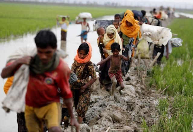 <p>Rohingya refugees walk on the muddy path after crossing the Bangladesh-Myanmar border in Teknaf, Bangladesh, Sept. 3, 2017. (Photo: Mohammad Ponir Hossain/Reuters) </p>