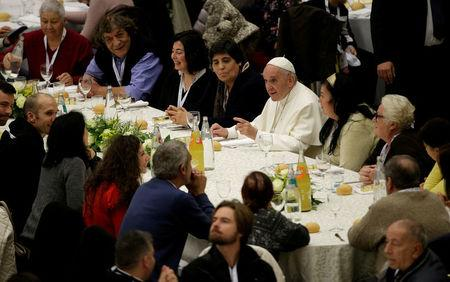 Pope Francis has lunch with the poor following a special mass to mark the new World Day of the Poor in Paul VI's hall at the Vatican, November 19, 2017. REUTERS/Max Rossi