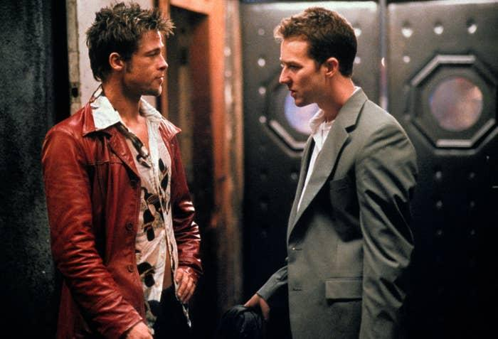 Brad Pitt and Edward Norton look at each other in a photo from Fight Club
