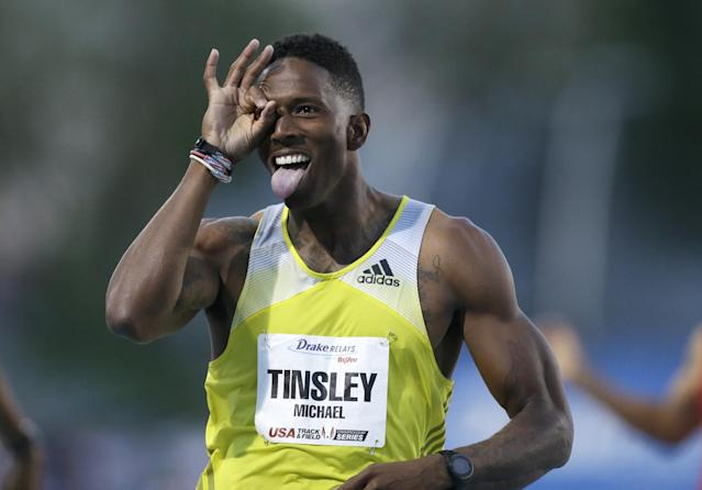 Michael Tinsley reacts as he wins the men's special 400-meter hurdles at the Drake Relays athletics meet, Friday, April 25, 2014, in Des Moines, Iowa. (AP Photo/Charlie Neibergall)
