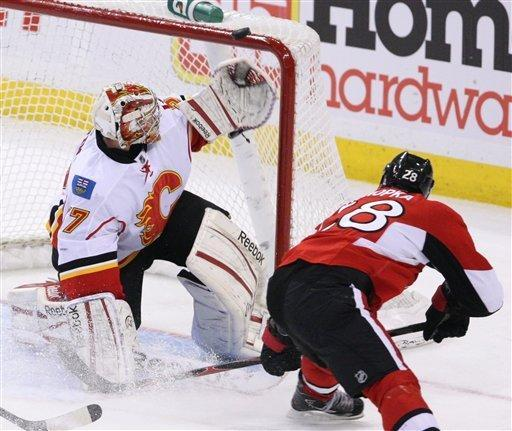 Calgary Flames goaltender Leland Irving (37) watches as Ottawa Senators Zenon Konopka's (28) shot goes over the crossbar during second-period NHL hockey game action in Ottawa, Ontario, Friday, Dec. 30, 2011. (AP Photo/The Canadian Press, Fred Chartrand)