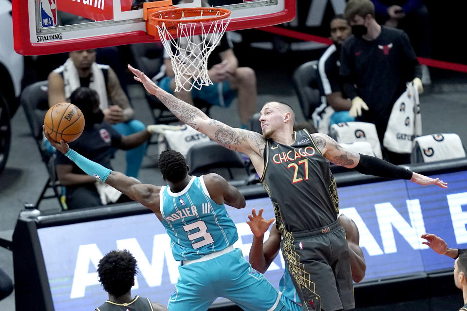 Charlotte Hornets' Terry Rozier (3) shoots past the outstretched arm of Chicago Bulls' Daniel Theis during the first half of an NBA basketball game Thursday, April 22, 2021, in Chicago. (AP Photo/Charles Rex Arbogast)