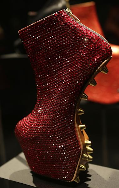 "This Feb. 11, 2013 photo shows an avant-garde, sequined platform heel designed by Noritaka Tatehana displayed at the ""Shoe Obsession"" exhibit at The Museum at the Fashion Institute of Technology Museum in New York. The exhibition, showing off 153 specimens, runs through April 13. (AP Photo/Kathy Willens)"