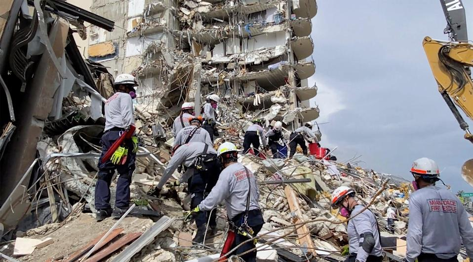 Search and rescue personnel search for survivors through the rubble at Champlain Towers (AP)