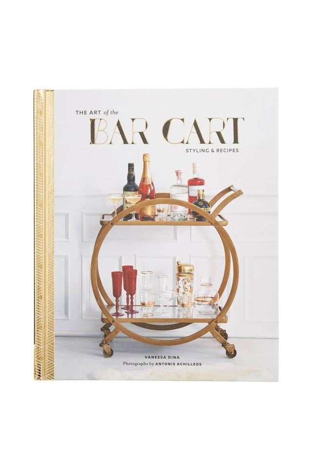 """<p><em>Chronicle Books, $23</em></p><p><a rel=""""nofollow"""" href=""""https://shop.nordstrom.com/s/the-art-of-the-bar-cart-styling-recipes-book/4793098"""">SHOP IT</a></p><p>Help her learn that the top of the kitchen cabinets aren't the most practical place to store her wine bottles. </p>"""