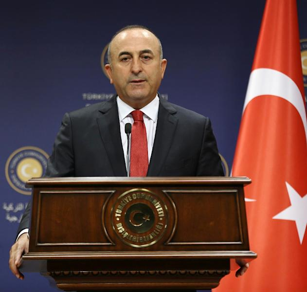 Turkish Foreign Minister Mevlut Cavusoglu gives a press conference in Ankara on July 25, 2015 as military embarked on new wave of air and artillery strikes against Islamic State jihadists in Syria and Kurdish militants in northern Iraq (AFP Photo/Adem Altan)