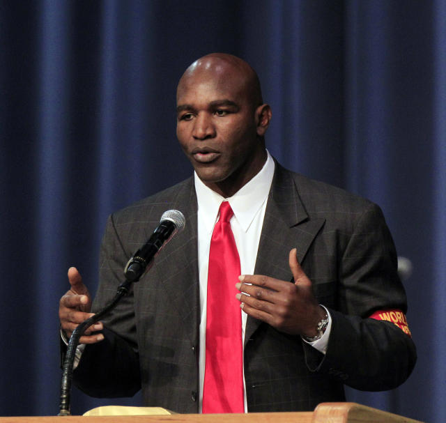 Former world champion boxer Evander Holyfield gives his remarks during a funeral service for the late boxing trainer Emanuel Steward at the Greater Grace Temple in Detroit, Tuesday, Nov. 13, 2012. (AP Photo/Carlos Osorio)