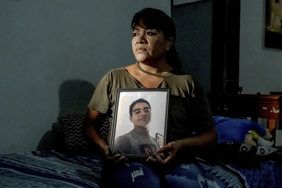**EMBARGO: No electronic distribution, Web posting or street sales before 3:01 a.m. ET Monday, Oct. 4, 2021. No exceptions for any reasons. EMBARGO set by source.** Noemy Padilla holds a portrait of her missing son who vanished in 2019, at her home in Mazatlán, Mexico, on June 8, 2021. Across Mexico, mothers hunt for a scrap that points toward their son or daughter. (Fred Ramos/The New York Times)