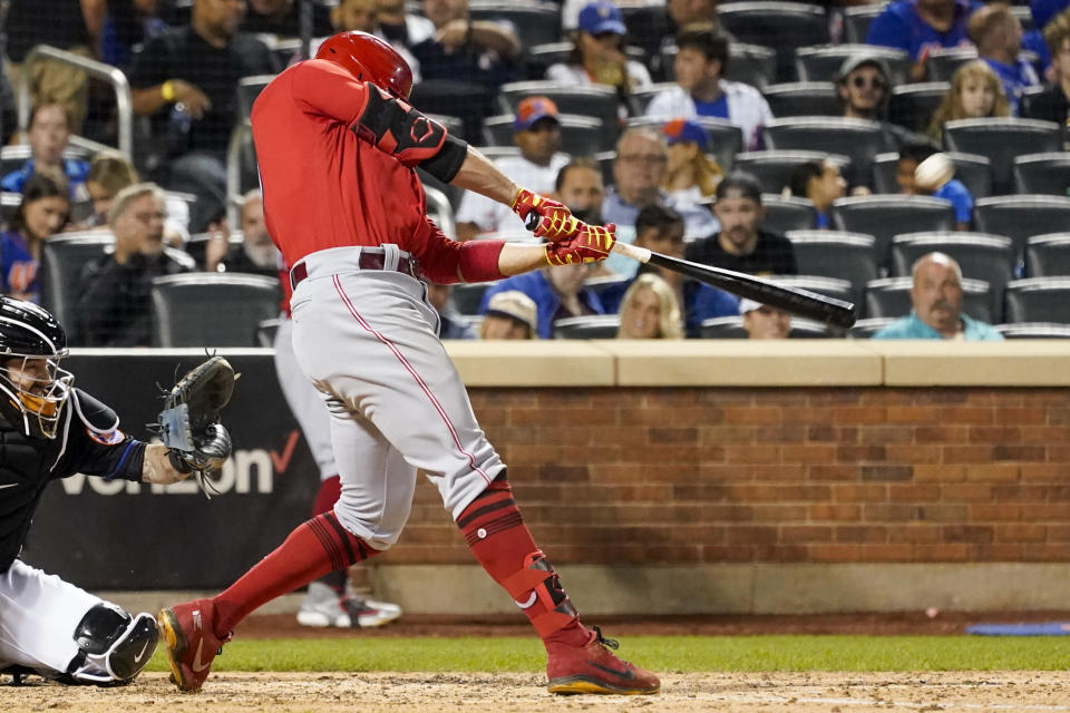 Cincinnati Reds' Joey Votto hits a solo home run in the sixth inning of the baseball game against the New York Mets, Friday, July 30, 2021, in New York. (AP Photo/Mary Altaffer)