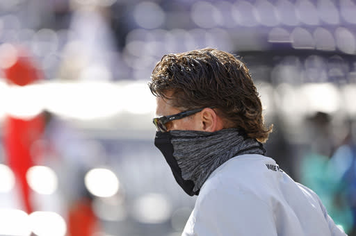 Oklahoma State head coach Mike Gundy runs on the field before playing TCU in an NCAA college football game Saturday, Dec. 5, 2020, in Fort Worth, Texas. (AP Photo/Ron Jenkins)