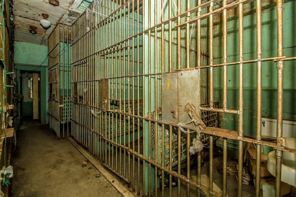 The home used to be a jail up until 1969, the cells are still part of the home. Source: realtor.com