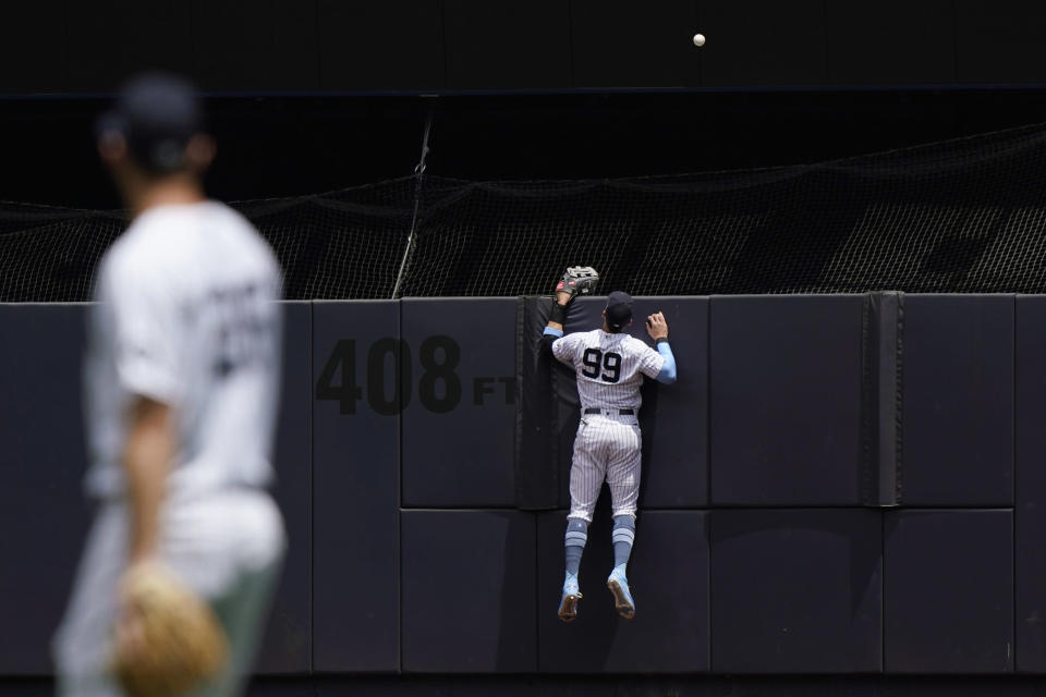 New York Yankees center fielder Aaron Judge (99) watches as a solo home run sails over the outfield wall during the first inning of a baseball game, Sunday, June 20, 2021, at Yankee Stadium in New York. (AP Photo/Kathy Willens)
